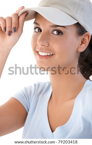 Portrait of attractive young girl in baseball cap, smiling at camera.? - stock photo
