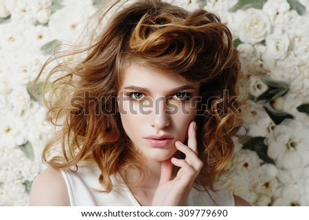 Portrait of attractive young girl on a background of white flowers, the concept of beauty and health - stock photo