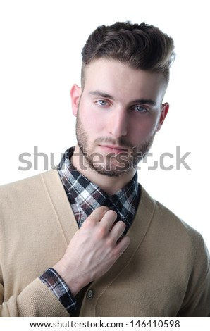 Portrait of attractive young man with shirt and sweater, isolated  on white - stock photo
