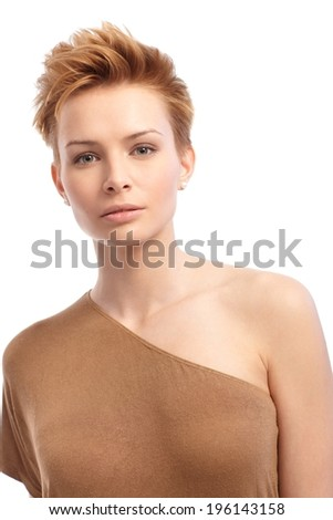 Portrait of attractive young trendy woman with short hair.
