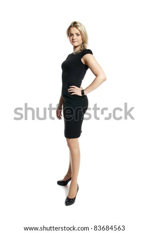 Portrait of attractive young woman in a black dress looking at camera. - stock photo