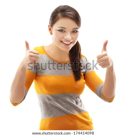 Portrait of attractive young woman laughing at camera with thumbs up.White background - stock photo