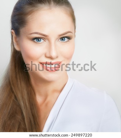 Portrait of attractive young woman on grey background - stock photo