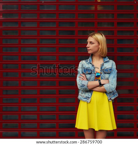 Portrait of attractive young woman standing on blank copy space background for your text message or content, stylish female looking to the space for your promotion or publicity information - stock photo