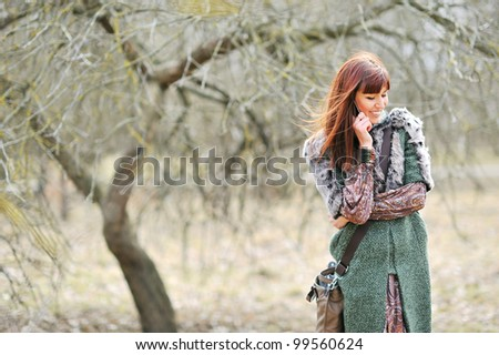 Portrait of attractive young woman talking on the mobile phone - stock photo