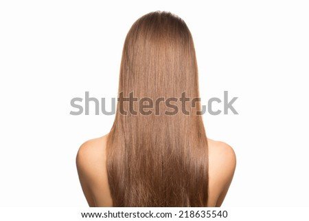 Portrait of attractive young woman with beautiful bridal hairstyle with tress, rear view - stock photo