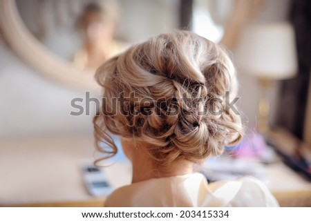 Portrait of attractive young woman with beautiful hairstyle - stock photo