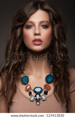 Portrait of attractive young woman with beautiful necklace - stock photo