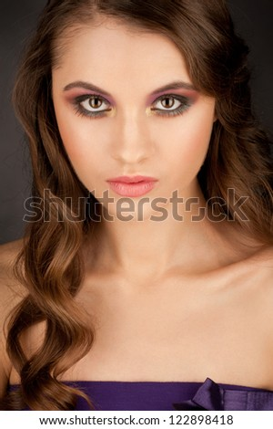 Portrait of attractive young woman with stylish bright makeup - stock photo