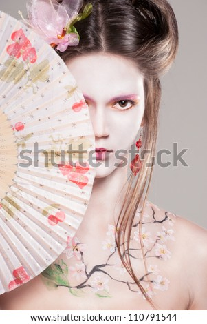 Portrait of attractive young women in asian style with sakura body art - stock photo