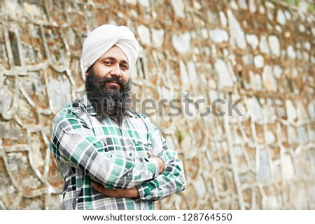 Portrait of authentic Indian sikh man in turban with bushy beard - stock photo