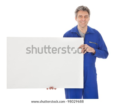 Portrait of automechanic holding empty banner. Isolated on white