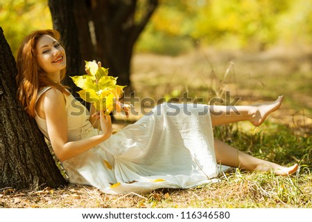 portrait of autumn happy woman with leaves