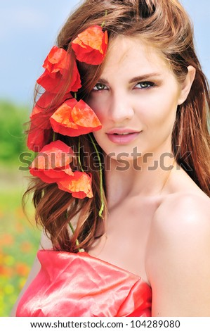 portrait of awesome beautiful girl with poppies