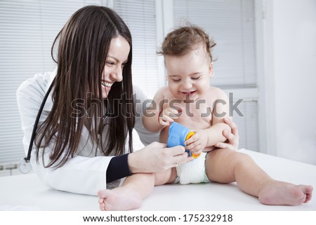 Portrait of baby and doctor
