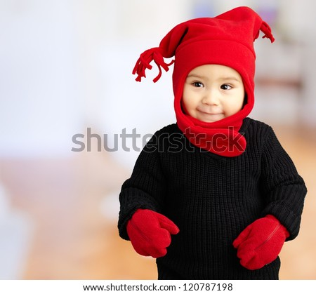 Portrait Of Baby Boy Wearing Warm Clothing against an abstract background - stock photo