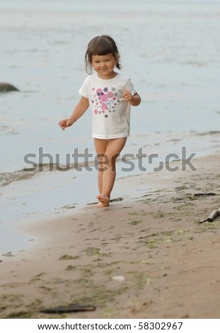 Portrait of baby by the sea - stock photo