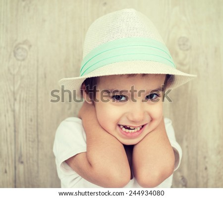 Portrait of baby child with hat - stock photo