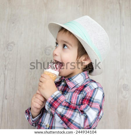 Portrait of baby child with sweet ice cream - stock photo