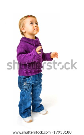 Portrait of baby girl looking up - stock photo