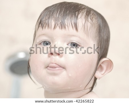 Portrait of baby in bath