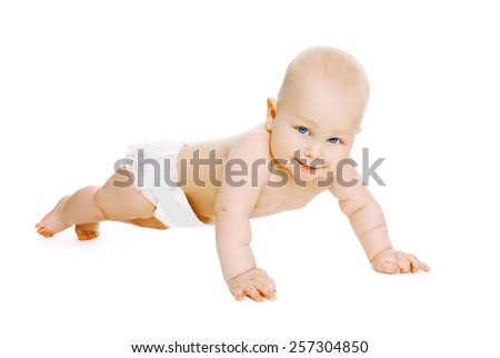 Portrait of baby in diapers crawls on the floor - stock photo