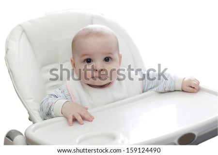 Portrait of baby in highchair on the white background - stock photo