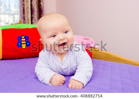 portrait of baby. laughing baby - stock photo