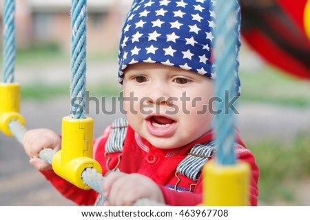 portrait of baby on playground