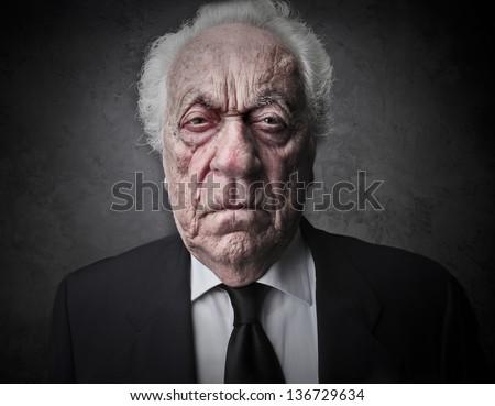 portrait of bad old businessman - stock photo