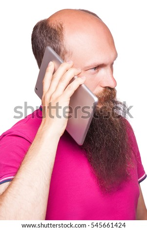 Portrait of bald bearded man with tablet and pink t-shirt isolated on white background.