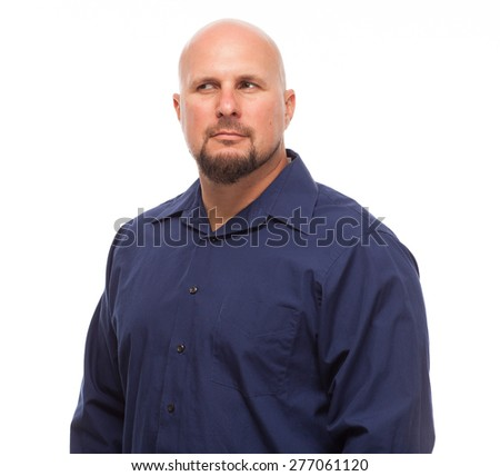Portrait of bald, handsome young man isolated on white background. Caucasian man with beard looking off to side and suspicious. - stock photo