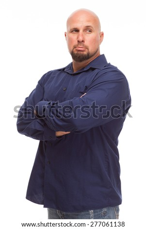 Portrait of bald, handsome young man isolated on white background. Caucasian man with beard looking sad with arms crossed. - stock photo