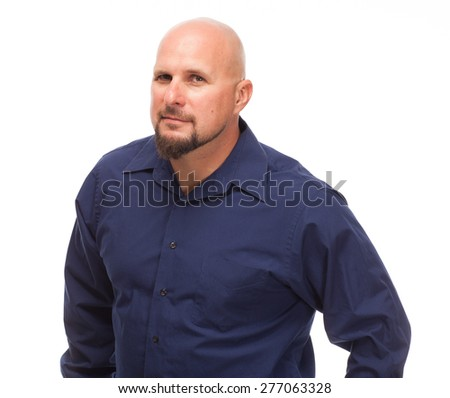 Portrait of bald, handsome young man isolated on white background. Caucasian man with beard looking at the camera. - stock photo