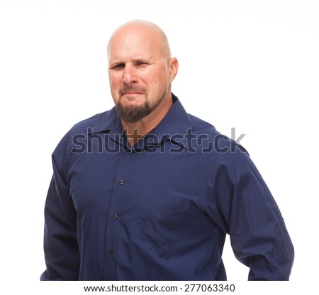 Portrait of bald, handsome young man isolated on white background. Caucasian man with beard with a sour expression. - stock photo