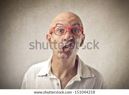 portrait of bald man grimacing - stock photo