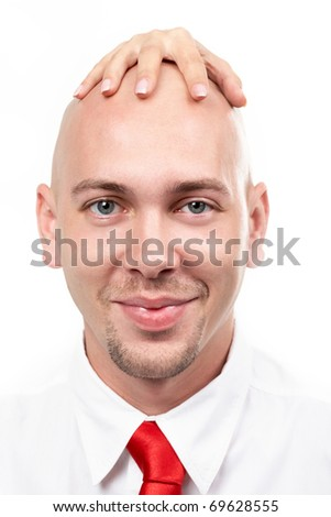 Portrait of bald man with female hand on his head - stock photo