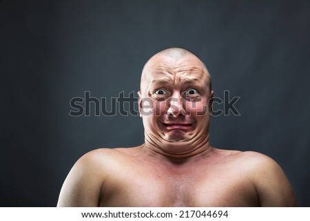 Portrait of bald scared man - stock photo