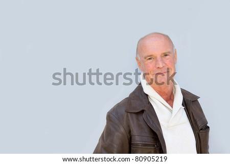 Portrait of bald senior man - stock photo
