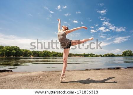 portrait of  ballet dancer outdoor, ballerina dancing outdoor - stock photo