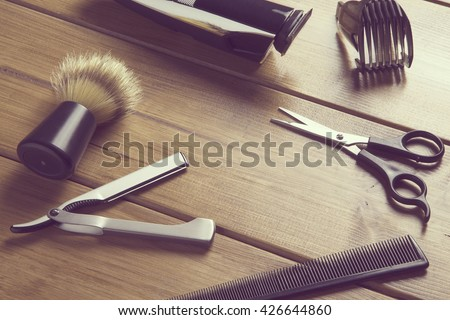 portrait of barber tools on wood top / essentials tools for barber - stock photo