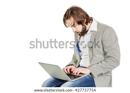 portrait of bearded business man working on his laptop. emotions, facial expressions, feelings, body language, signs. image on a white studio background. - stock photo
