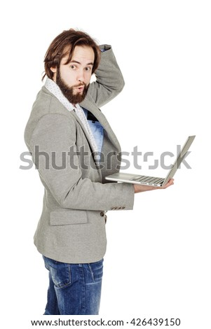 portrait of bearded businessman with laptop computer.  human emotion expression and office, business, technology, finances and internet concept. image isolated white background.
