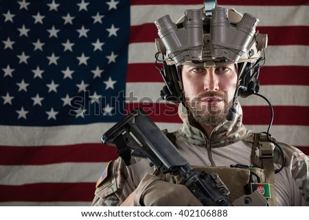 Portrait of Bearded US Army Soldier With Night Vision Goggles on American Flag Background - stock photo