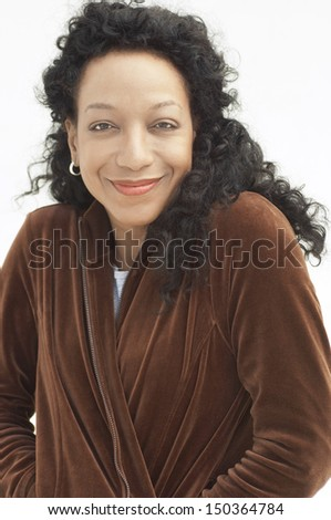 Portrait of beautiful African American woman smiling on white background - stock photo