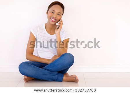 portrait of beautiful african girl talking on mobile phone - stock photo