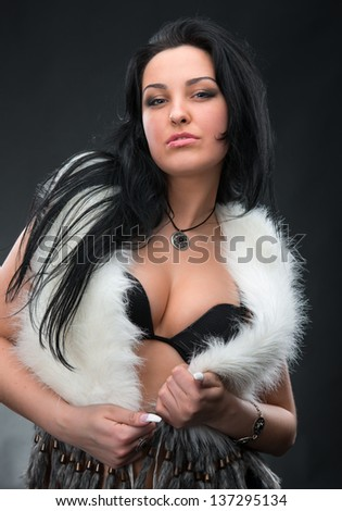 Portrait of beautiful and sexy woman on white background - stock photo