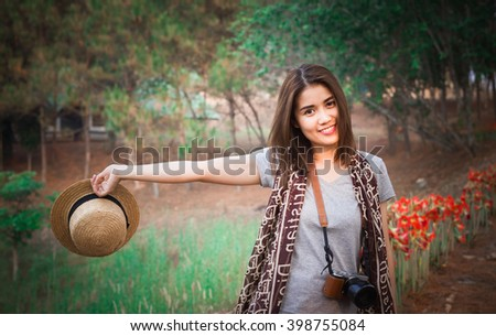 Portrait of Beautiful Asian Chinese/Japanese girl in white, outdoor - stock photo