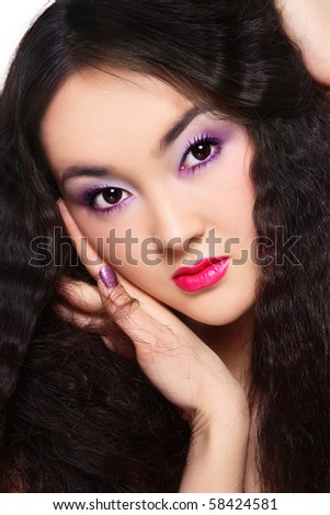 Portrait of beautiful asian girl with curly hair and stylish make-up