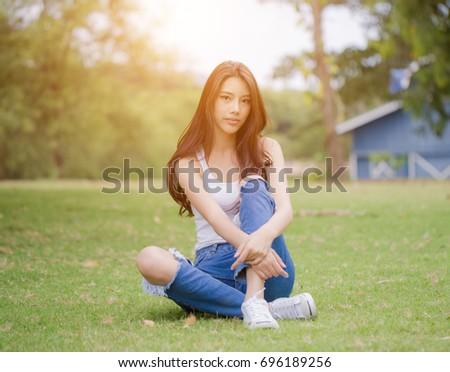 Beautiful asian woman photographing street dina